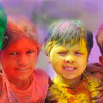 Annual Holi celebrations Group of kids playing Holi in India