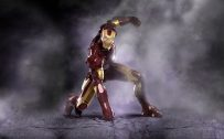 Cool Wallpaper with Iron Man Poses After Landing in the Battle