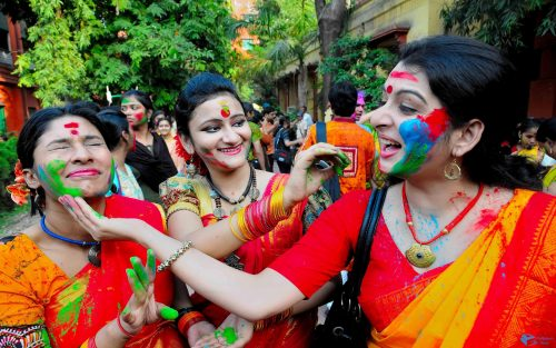 Holi Festival of Colors in India - Girls Playing Colorful Powders