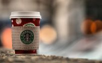 Starbucks Coffee Cup Wallpaper in Close Up with Blur effect