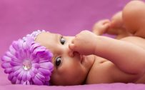 Cute New Baby Girl Wallpaper with Purple Background