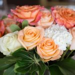 Flower Arrangements With Coral and White Roses with Carnations