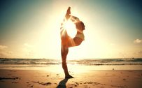 Yoga Pose with Sun Backlight in Beach