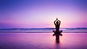 Yoga Wallpaper with Girl in a Purple Sunset at Beach